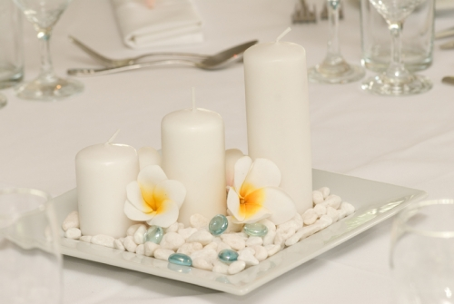 Beach tablecentre with candles and frangipani