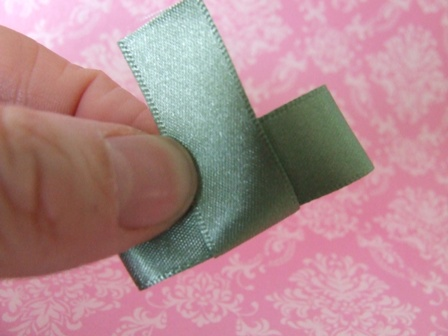Fold a smaller piece of ribbon around the centre