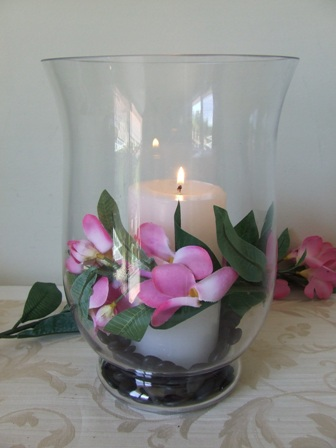 Hurricane lamp with pink frangipani